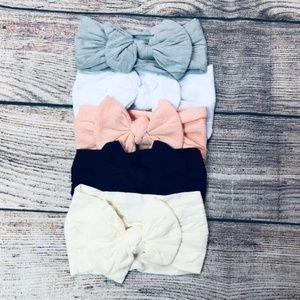 Set of 5 infant nylon bow headwraps; neutral tones